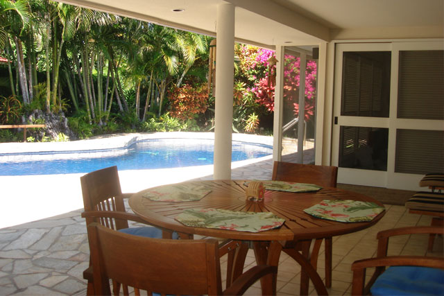 Dine poolside on covered lanai