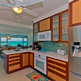 Kitchen looks past family room to ocean