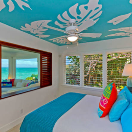 Bedroom in Lanikai vacation home with Aloha print ceiling