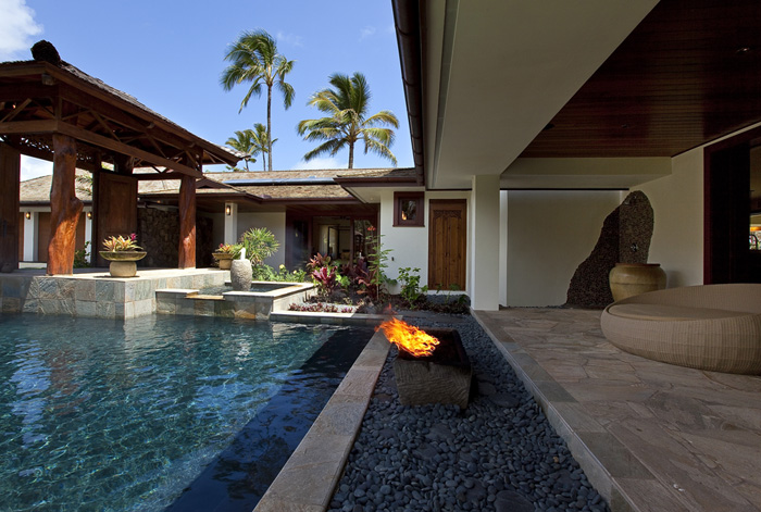 Swimming pool and deck with fire pit